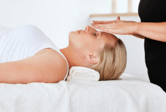 woman recieving Reiki