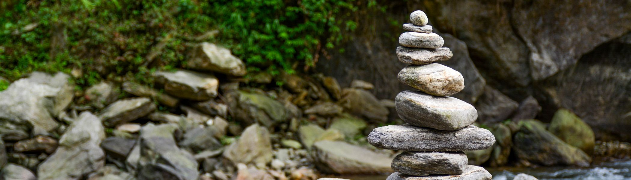 Stacked rocks over water