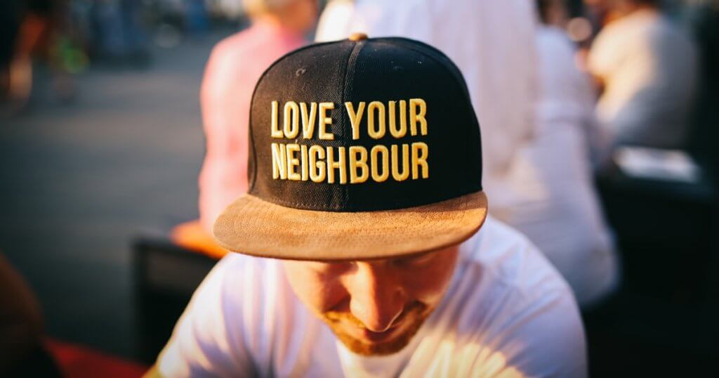 man wearing love your neighbor hate