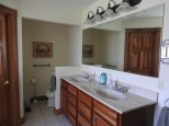 Private bath off Master Bedroom; double bowl vanity and toilet. Shower is to the right.