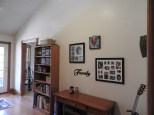 Back wall of living room; dining area through the door.
