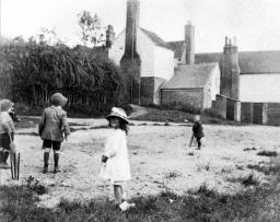 Sidley children playing on The Pond behind New Inn 1921