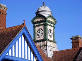 BW-079 - The elaborate clock turret in the centre of the building at Bexhill West has a lead dome and base with wooden clock faces. (October 2007)