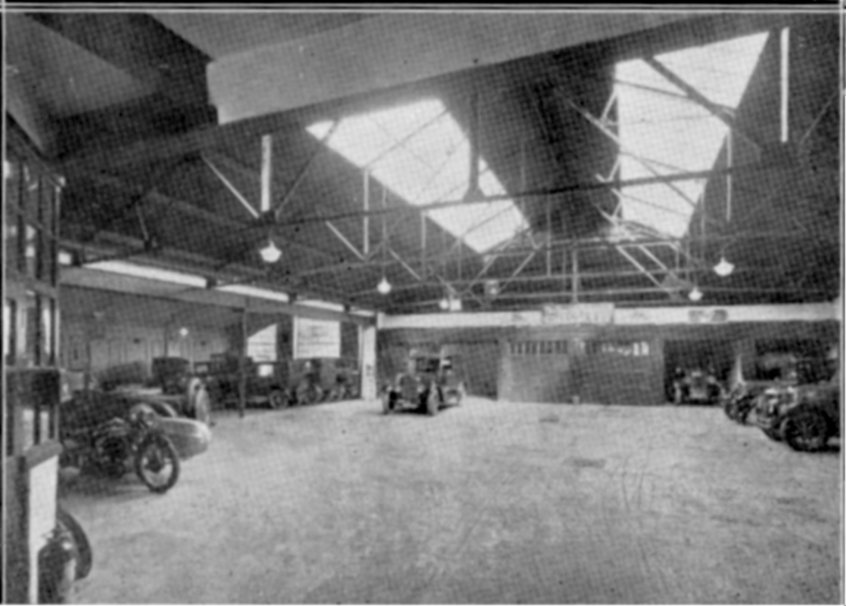 CL-004 Interior of the new portion of Western Road Garage showing period cars and motorbike & sidecar