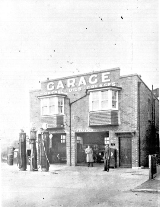 Mr E A Easton (on the right) stands proudly by his new garage in 1930