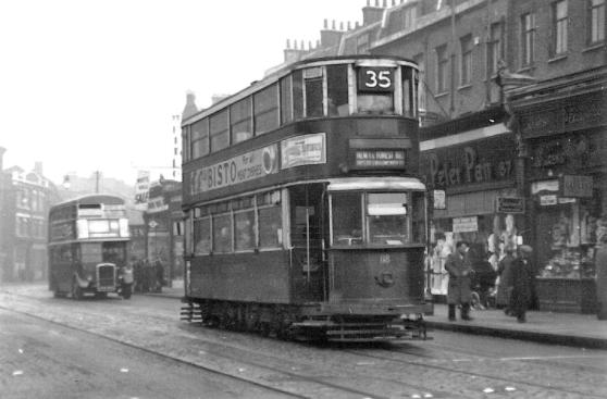 118 route 35 to Forest Hill with RTL bus behind, 16-3-1952