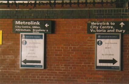 Metrolink signs, Piccadilly stn