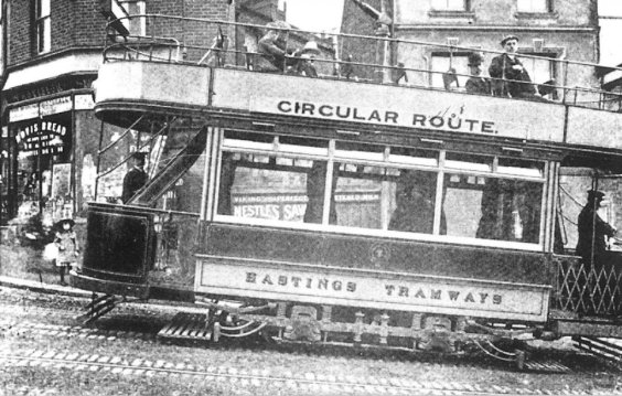 Side view tram on circular route cobbled road 1905