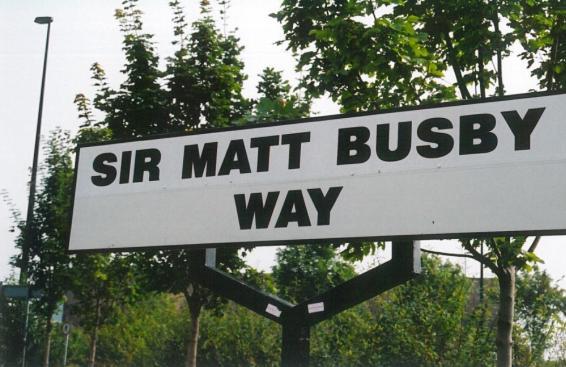 Sir Matt Busby street name plate from Trafford Park Rd