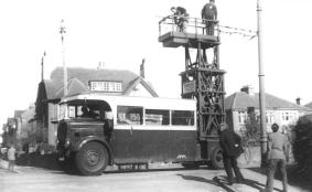 Tower wagon removing wires & support arms 1959