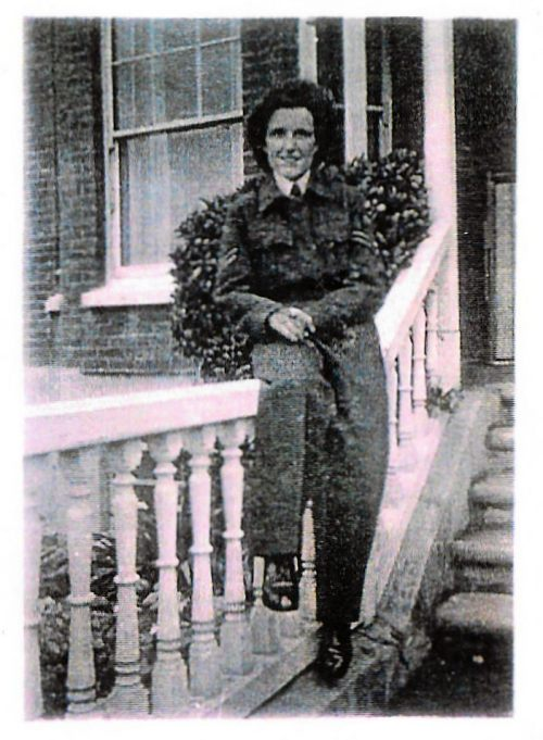 WAAF Corporal Radar Operator Mona Kelly at her digs in Eastbourne wearing her Battledress