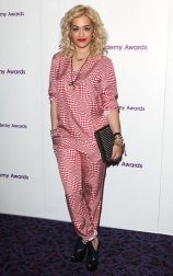 This simple jumpsuit with a bold red and white check pattern combined with styling touches such as rolling up the ankles a few times makes the outfit fresh and classic for the Radio Academy Awards in London, May 2012.