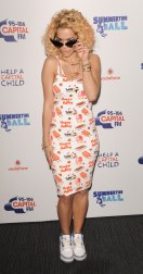 Showing off her cheeky side in this summery body-con dress with a playful ice cream print was perfect for Rita's breakthrough summer of 2012 at the Capital FM Summertime Ball in London, June 2012.