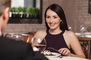 Attractive older woman on a dinner date - main