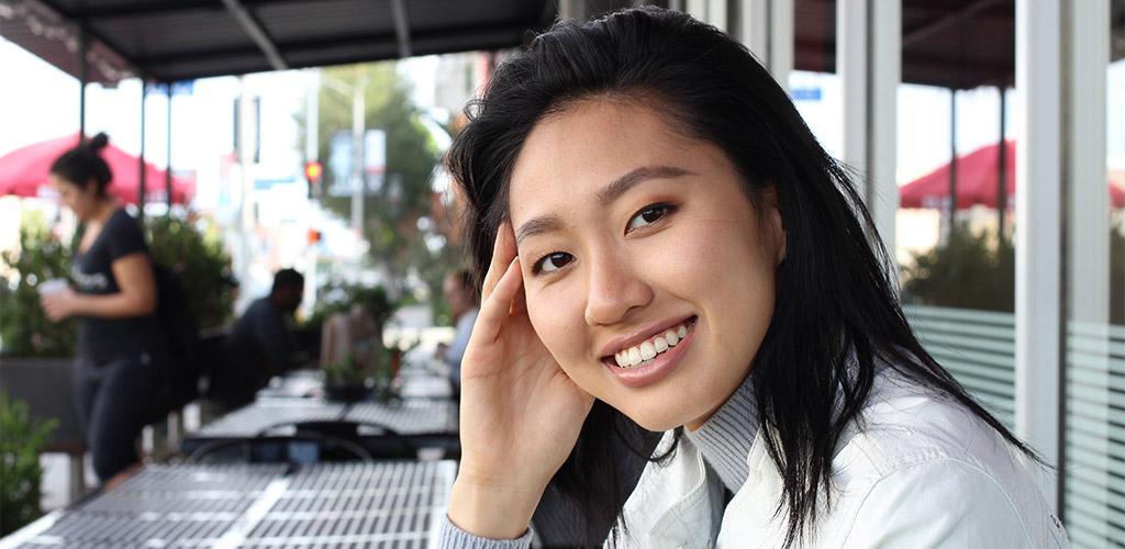 Smiling Korean Milf In A Cafe
