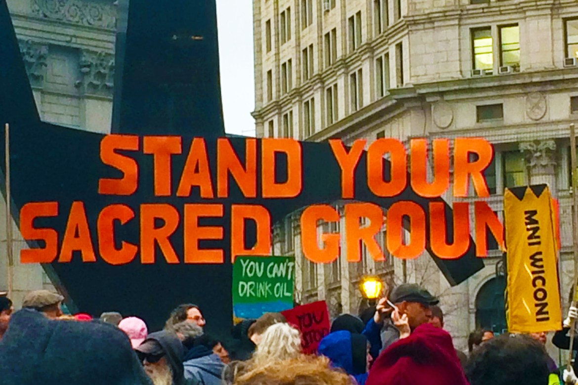 Standing Rocking protest. Stabd your sacred ground.