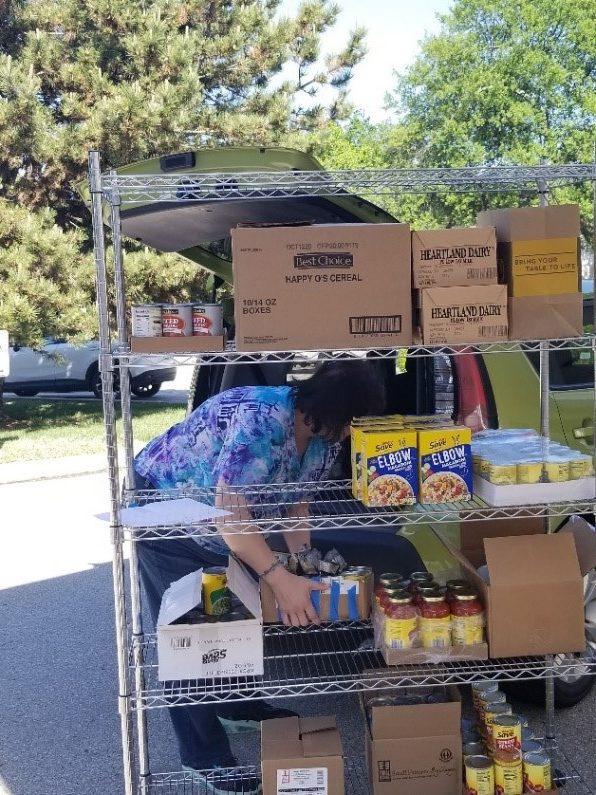 Volunteers pack food from our pantry