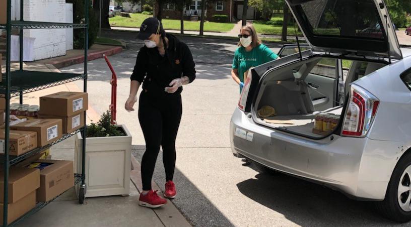 Volunteers loading a car