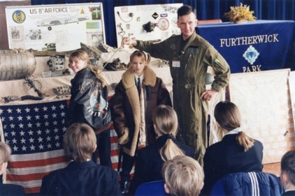 Gary and his two daughters demonstrating the jackets to Furtherwick Park School
