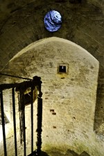 The hole above would act as a projector onto the floor in the caponier to watch for invading enemies from inside