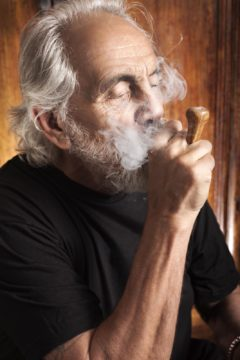 Tommy Chong smoking