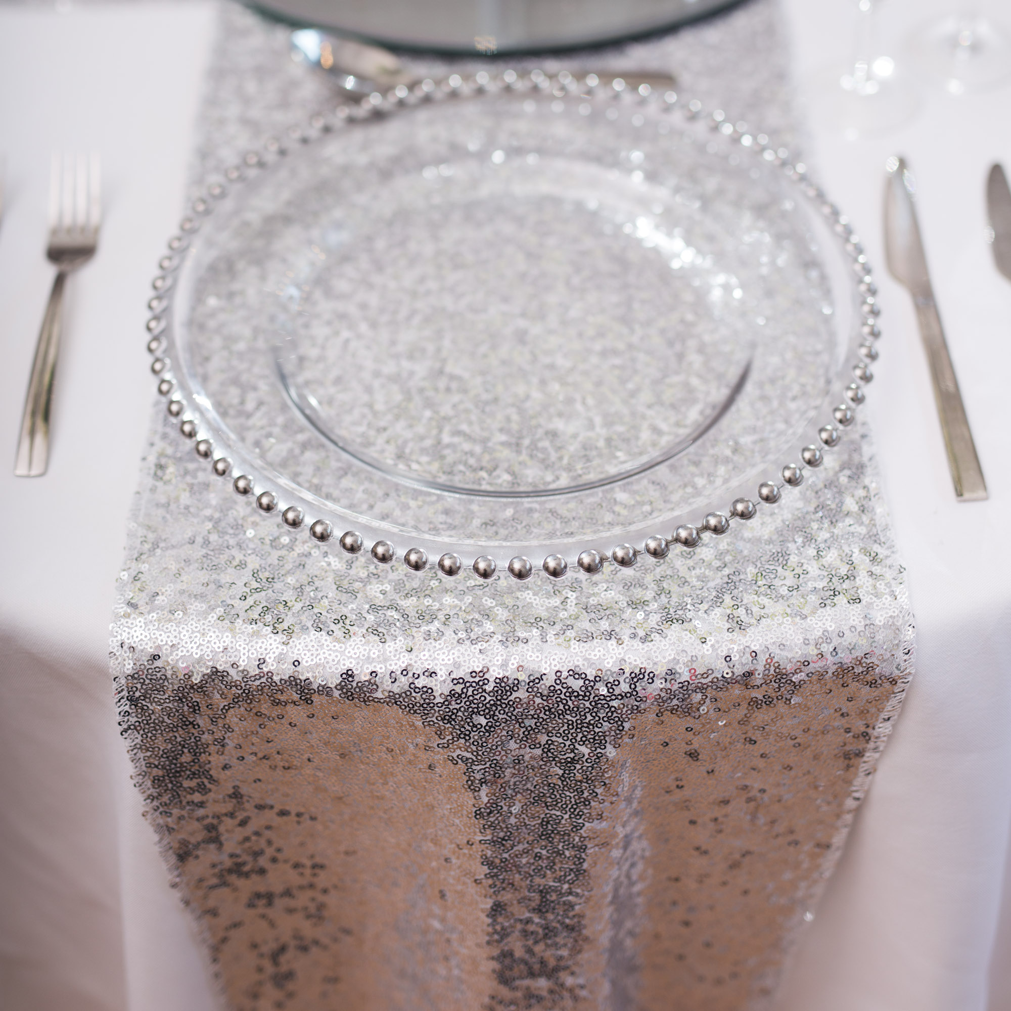 sequin chair covers uk monogrammed bean bag chairs kids silver table runner beyond expectations weddings