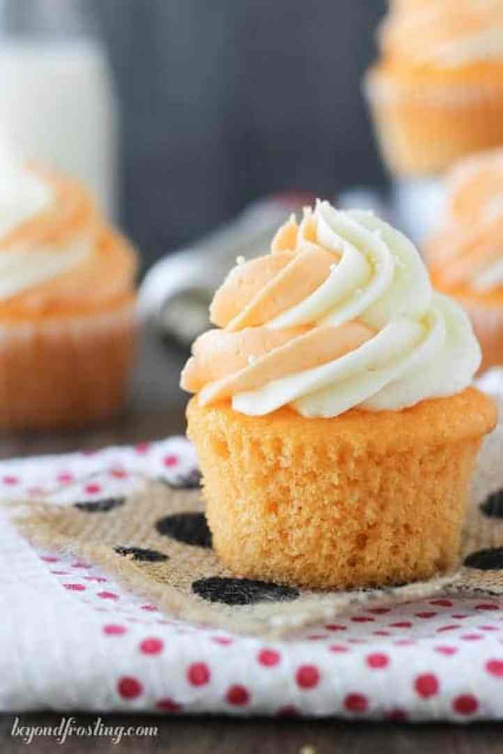 Orange Cream Pop Cupcakes. A moist orange cupcakes with a creamy vanilla and orange buttercream frosting.