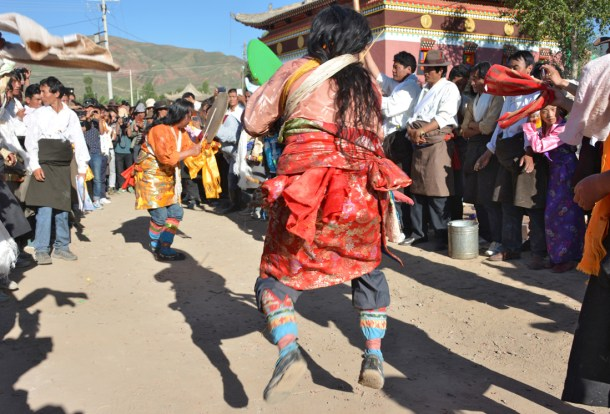 "Two Tibetan Lha-ba, Amyes-lhari and Amyes-magpa, perform ""goodbye"" at the end of the day."