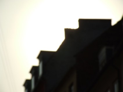 sun_behind_building