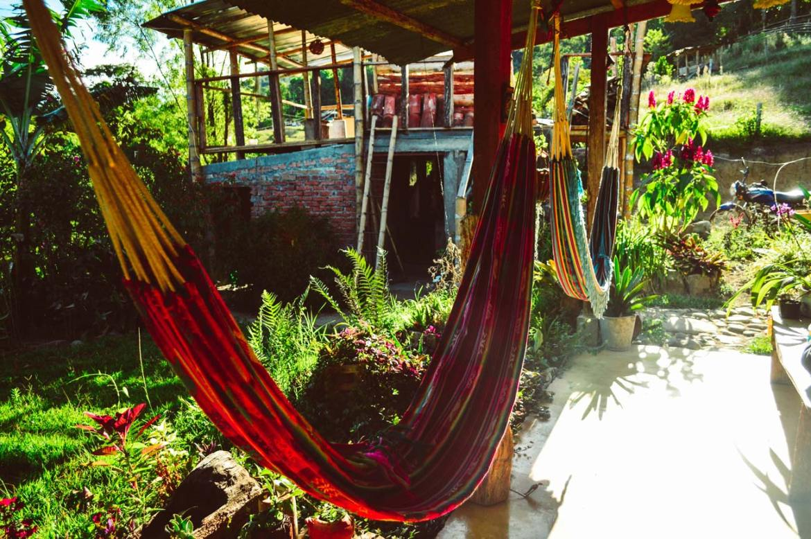 Two hammocks in view during sunrise