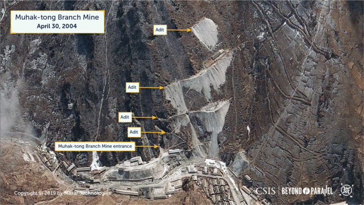 A view of the Muhak-tong Branch Mine, showing the mine entrance, the numerous adits above it, and the mine support buildings, April 30, 2004. (Copyright 2019 by Maxar Technologies)
