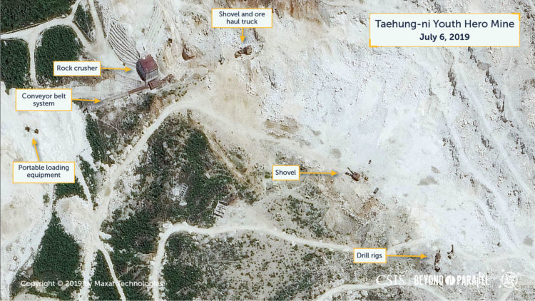 Close-up of the rock crusher and shovels, ore haul tucks, and drills at the Taehung Youth Hero Mine, July 6, 2019. (Copyright 2019 by Maxar Technologies)