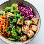 soba noodle bowl with baked tofu, romanesco, and pickled carrot, cucumber, and purple cabbage