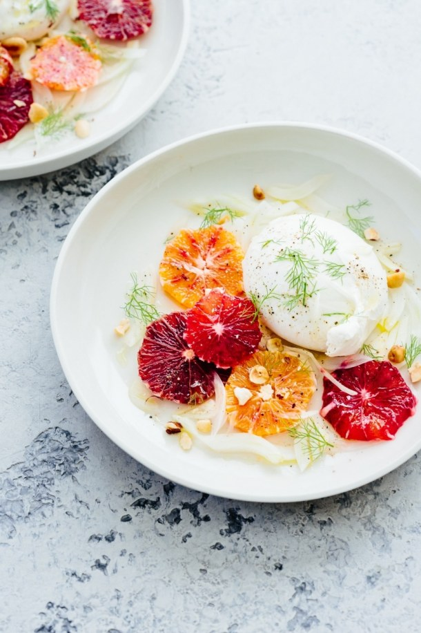 two plates of burrata blood orange and fennel salad
