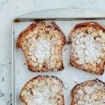 Five slices of Meyer lemon bostocks and sieve on baking sheet and