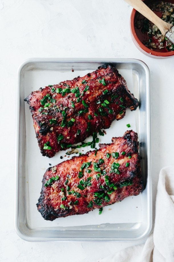a tray with two slabs of grilled Vietnamese lemongrass pork ribs