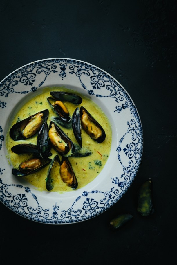 bowl of mouclade mussels in cream and curry sauce