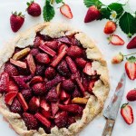 strawberry rhubarb mascarpone galette with cutting knife and strawberries