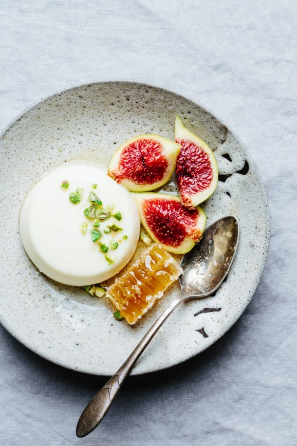 plate of orange blossom panna cotta with figs and honeycomb