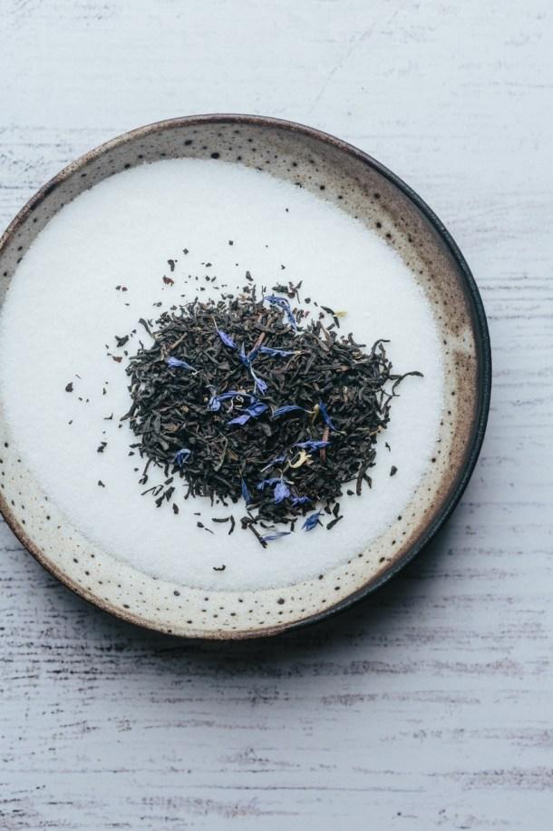 a bowl of Earl grey tea leaves and sugar