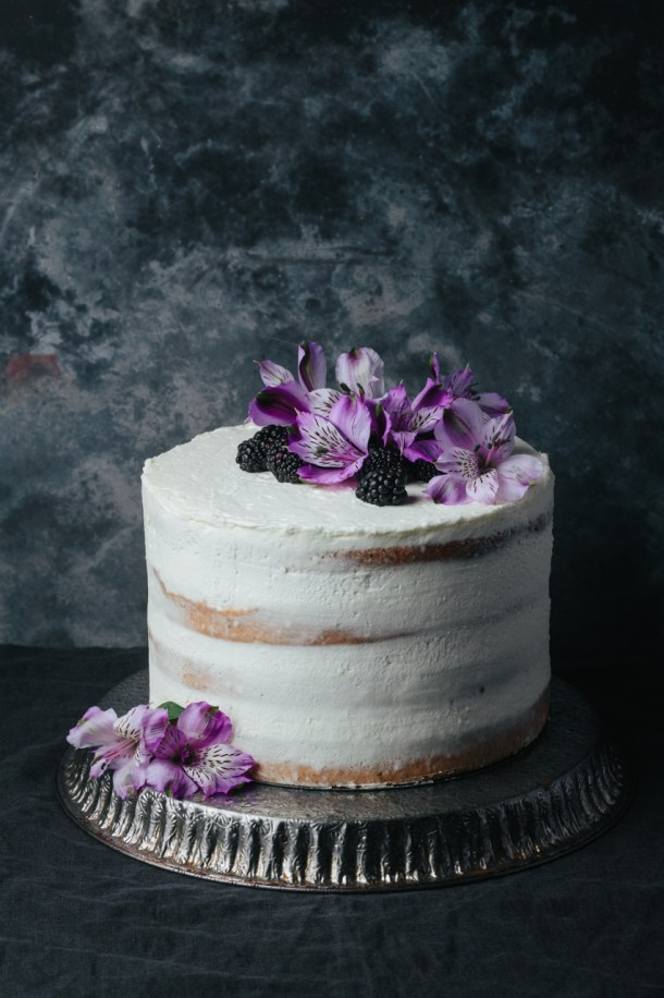 blackberry Earl Grey cake on a metal stand