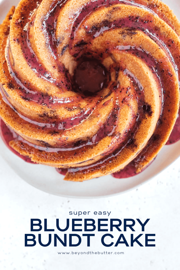 Overhead image of super easy blueberry bundt cake recipe with blueberry glaze drizzled over the top   All Images © Beyond the Butter, LLC