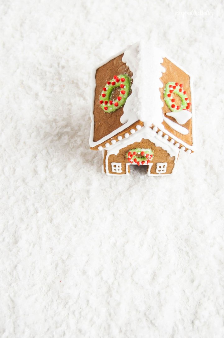 Homemade Gingerbread Houses - Overlooking the roof of one gingerbread house with wreaths on each side | All Images © Beyond the Butter, LLC
