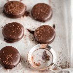 Homemade Peppermint Patties | Angled shot of Homemade Peppermint Patties drizzled in chocolate and dusted lightly with cocoa | Image Credit and Copyright: Beyond the Butter, LLC