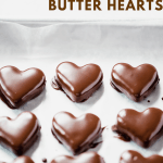 Chocolate Covered Peanut Butter Hearts | Angled view of chocolate peanut butter hearts that have been dipped in chocolate and placed on a cookie sheet | Image and Copyright Policy: Beyond the Butter, LLC