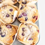 Overhead image of lemon blueberry streusel muffins in a muffin tin | All Images © Beyond the Butter™