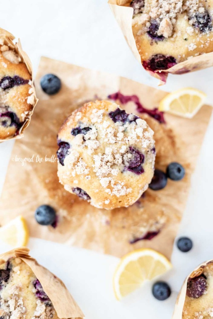 Overhead image of unwrapped lemon blueberry muffins | All Images © Beyond the Butter™