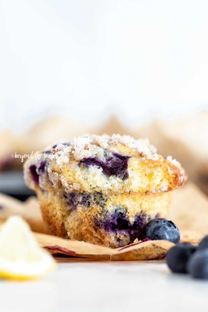 Image of unwrapped bakery style lemon blueberry streusel muffin | All Images © Beyond the Butter™