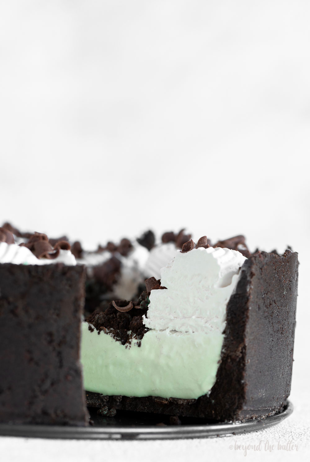 No Bake Mint Chocolate Pie | Up close photo of sliced mint chocolate pie | Image and Copyright Policy: © Beyond the Butter, LLC.