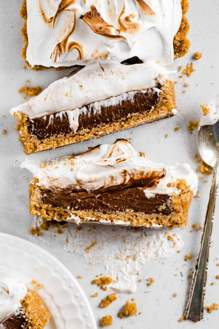 Overhead image of chocolate marshmallow tart with 2 slices cut and laid on their side | All Images © Beyond the Butter™